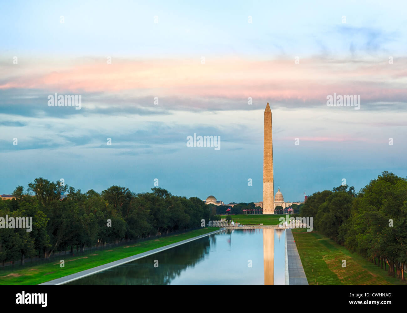 Setting sun illuminates Washington Monument in DC and Capitol with reflections in new Reflecting Pool, USA - Stock Image