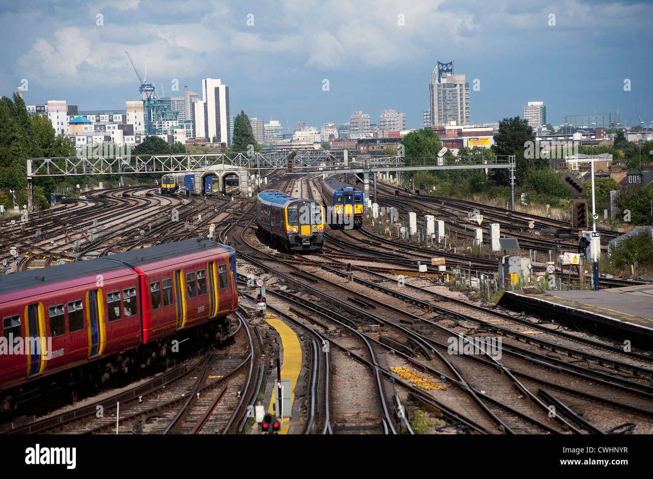 Various trains at Clapham Junction, one of the busiest railway junctions in England. - Stock Image