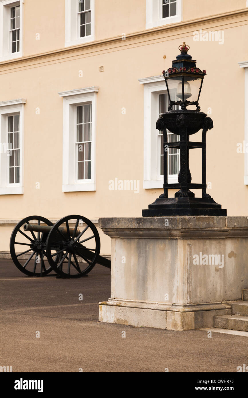 canon and wrought iron lamp outside the Old College Building Royal Military Academy Sandhurst - Stock Image