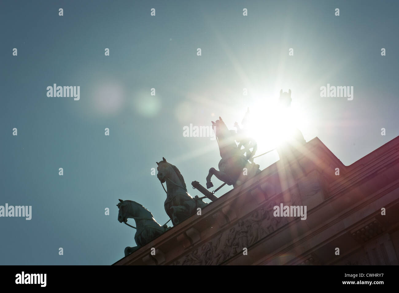 backlighting,berlin,brandenburg gate,quadriga statue - Stock Image