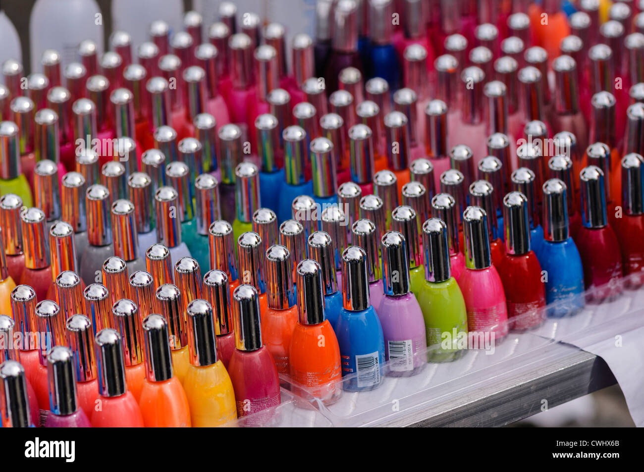 Lots of bottles of nail varnish all different colours Stock Photo ...