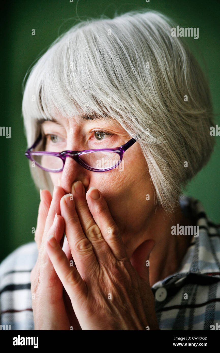 senior,doubts,worry,worried - Stock Image