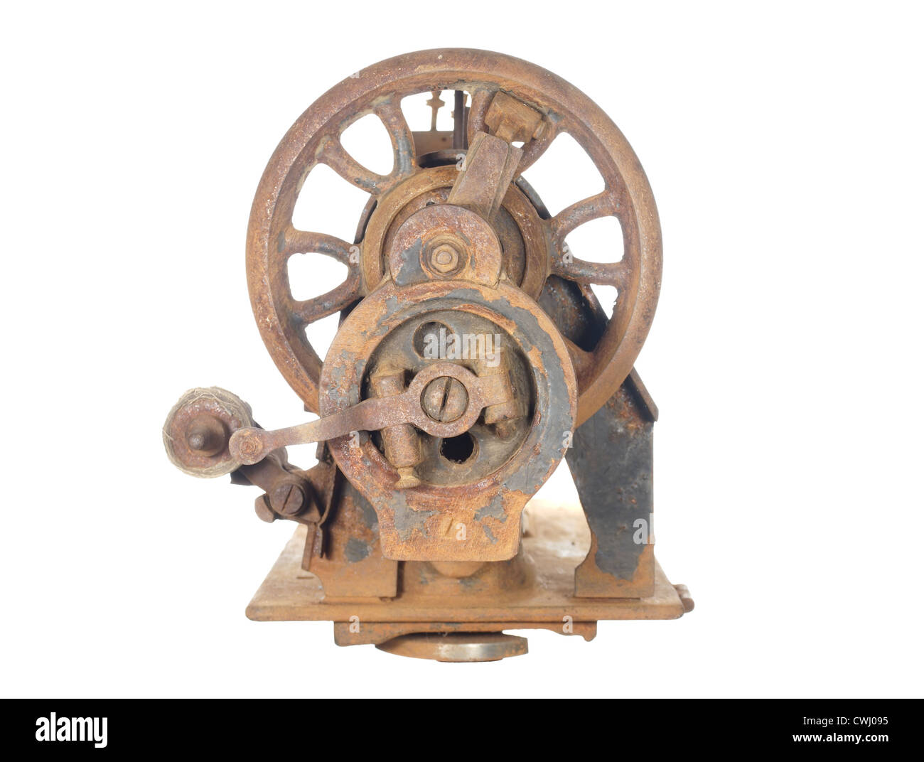 Rusty skeleton of an ancient sewing machine, isolated on white background. - Stock Image