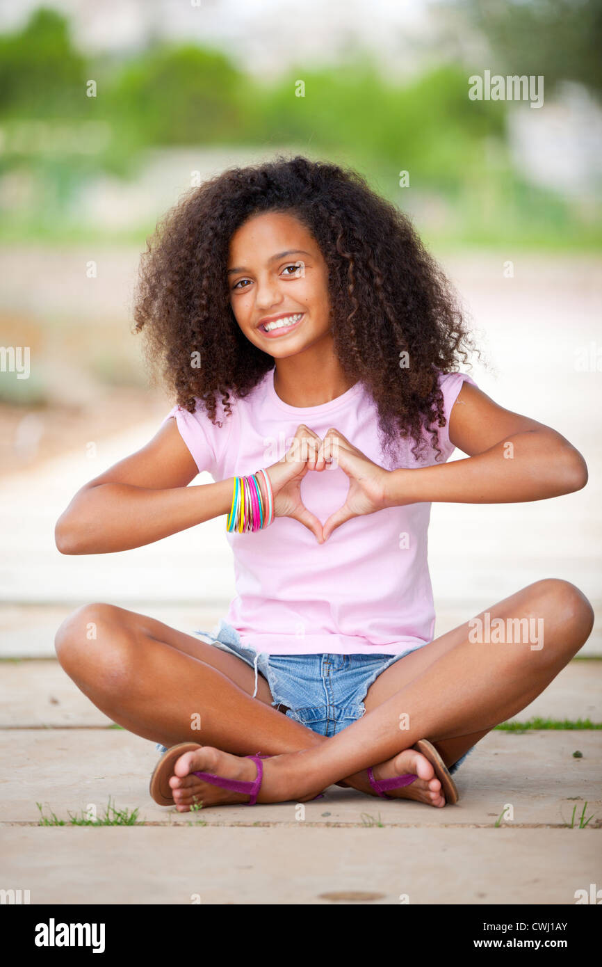Young Happy Smiling African American Black Teen Girl With