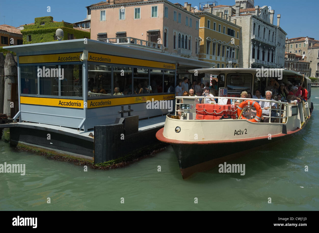 A vaporetto at the Accademia vaporetto stop on the Canal Grande, Venice. - Stock Image