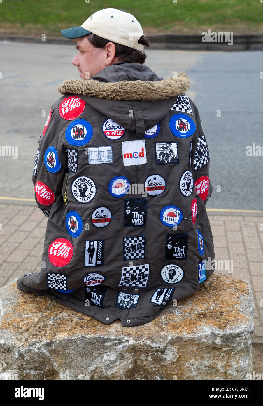 Decorated Parka with Mod Patches International Scooter Rally Isle of Wight England UK - Stock Image