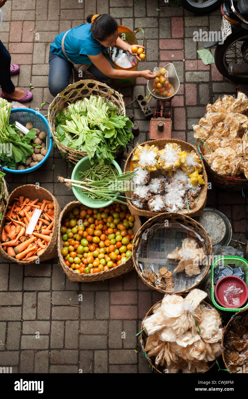 The Ubud, Bali Public Market is a very busy and colorful place with shoppers and sellers arriving very early in - Stock Image