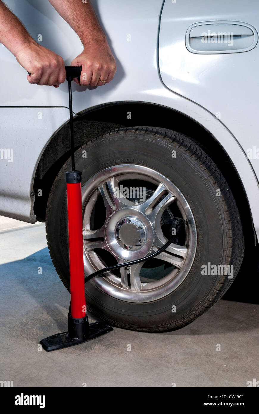 How To Put Air In Car Tires >> Using A Hand Pump To Fill A Car Tire With Air Stock Photo