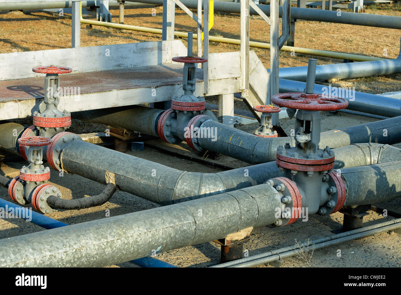valve, industry, pipes, pipeline, steel, oil, pressure, equipment, tube, metal, technology, flanges, bolts, factory, - Stock Image