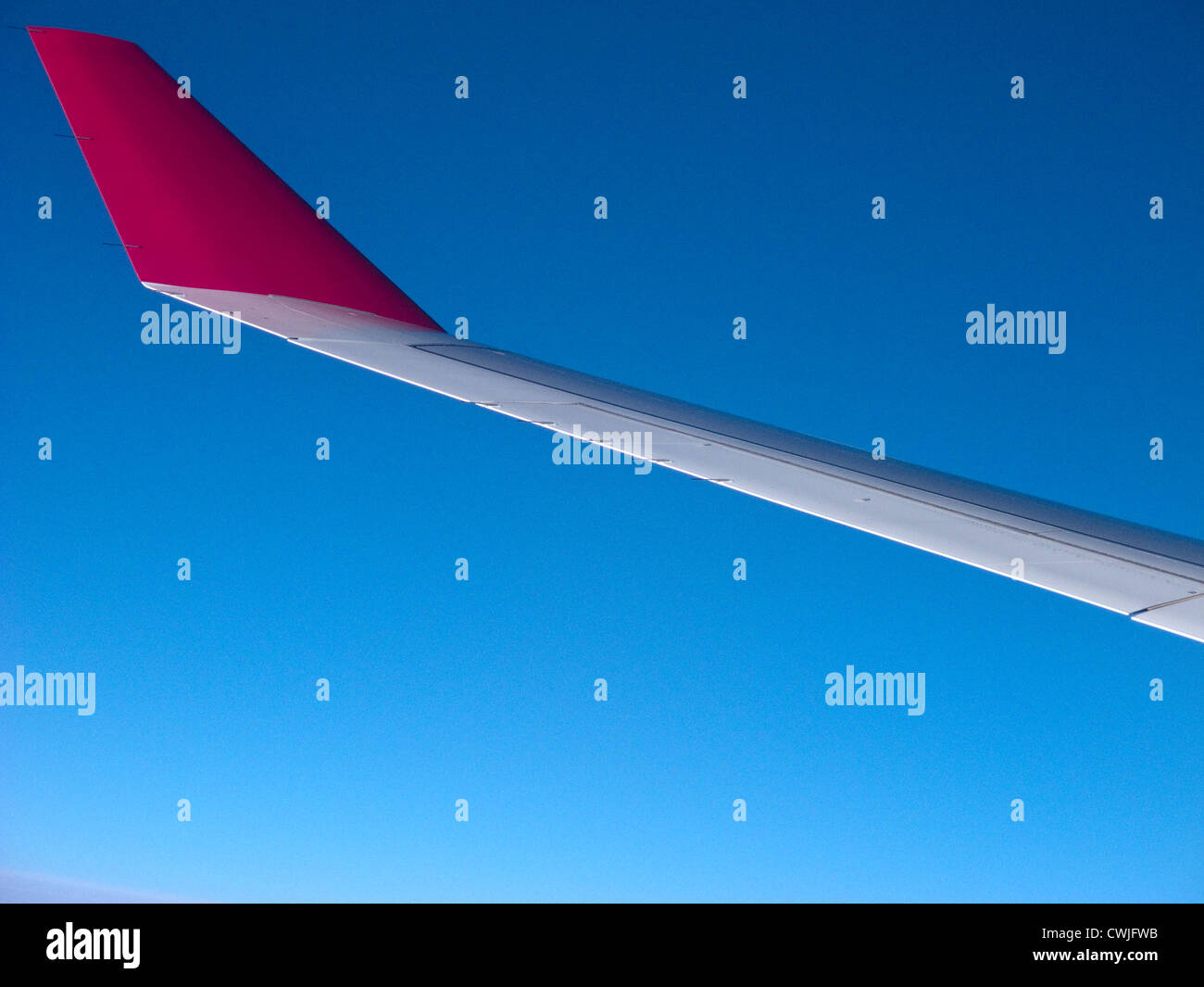 The wing tip of an Etihad Airways Airbus A340 - Stock Image
