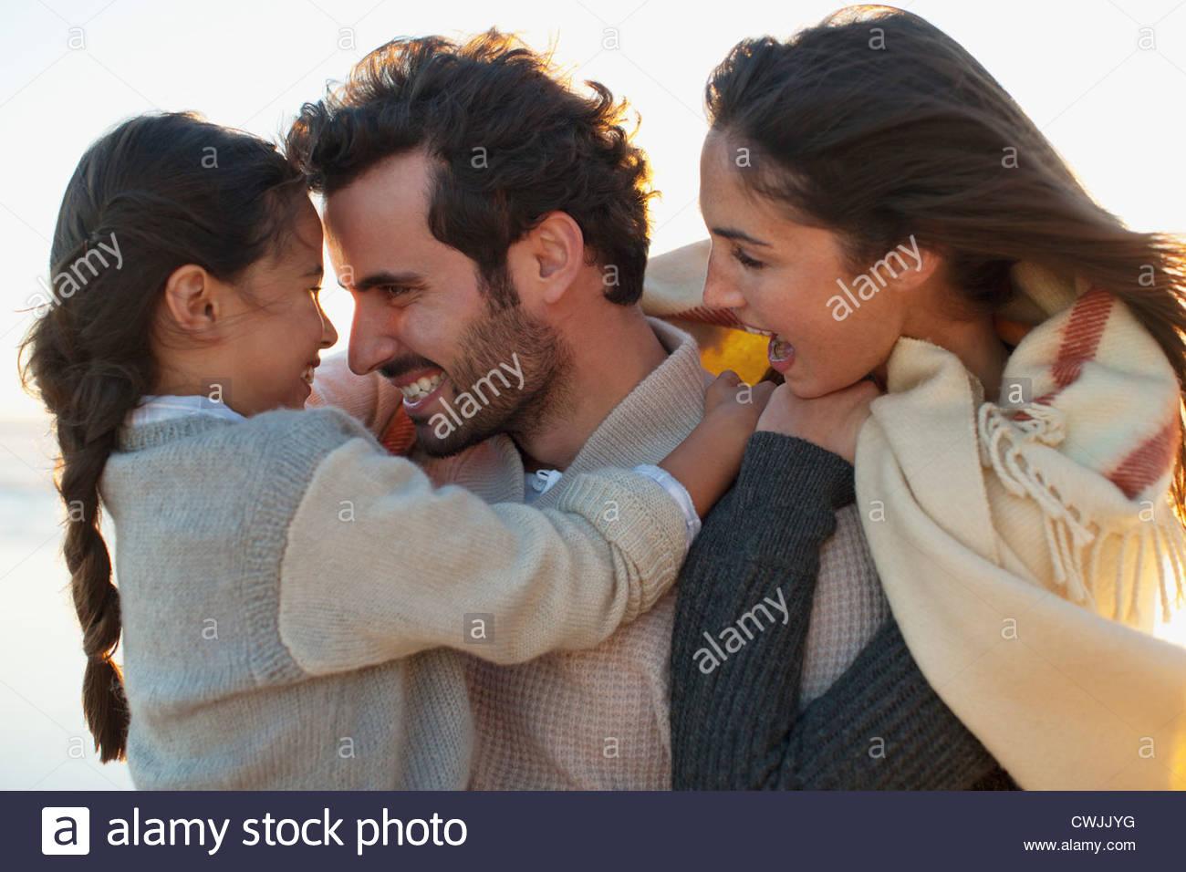 Smiling family hugging - Stock Image