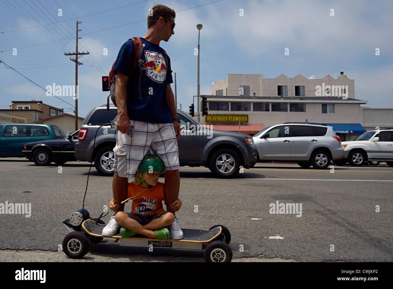 motorized skateboard venice beach california - Stock Image