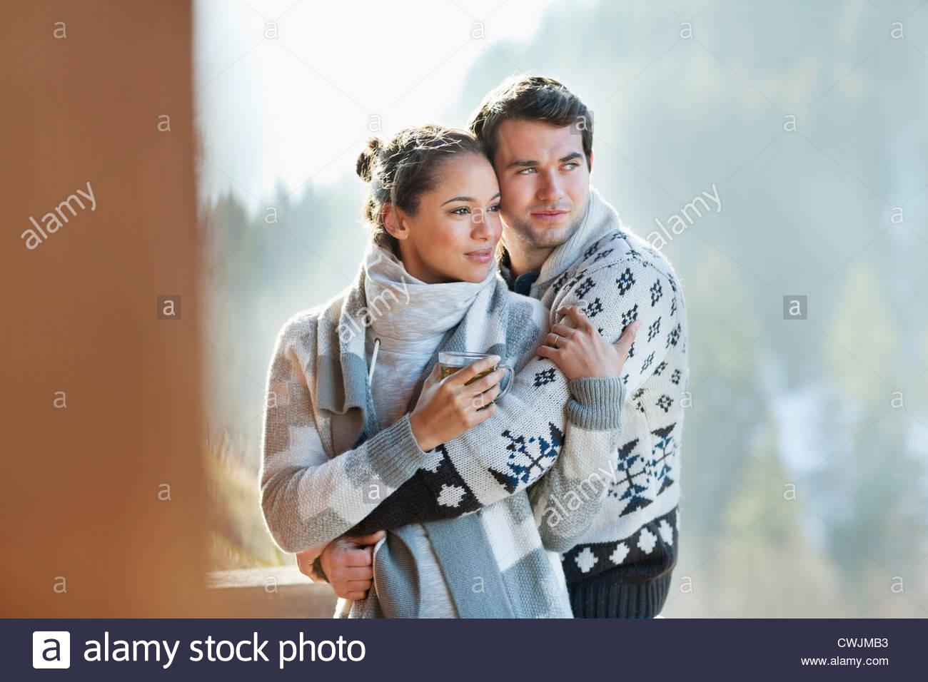 Couple hugging on patio - Stock Image