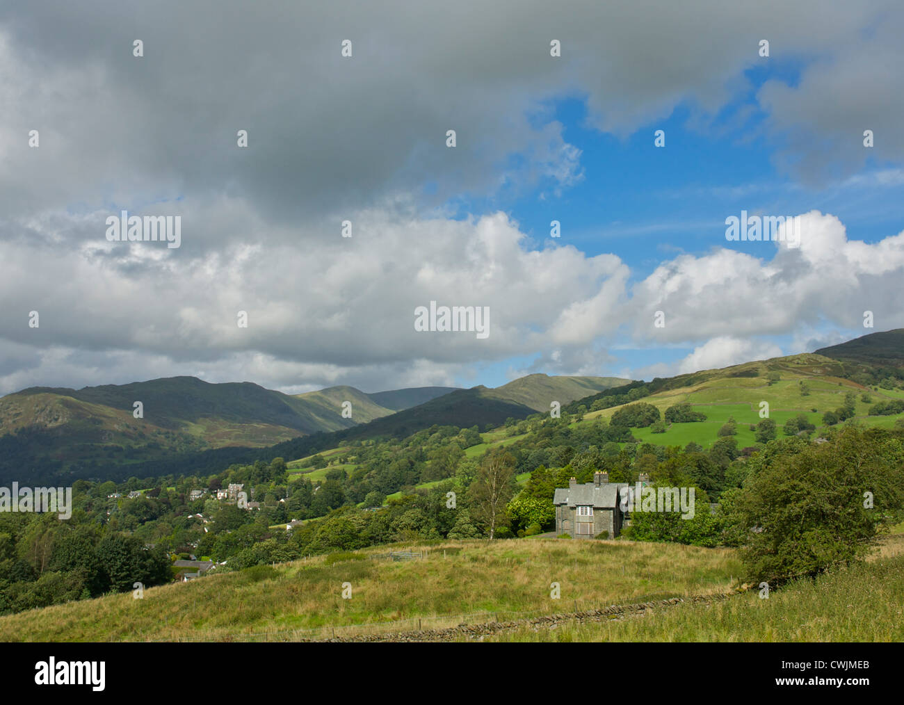 Kelsick Grammar School - now closed - on the outskirts of Ambleside, looking towards Red Screes and the Fairfield - Stock Image