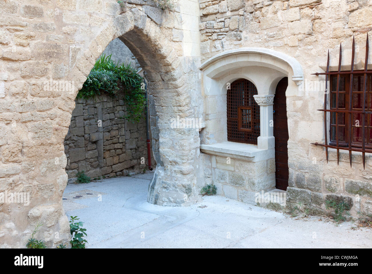 old archways and modern stone window in viens provence france stock