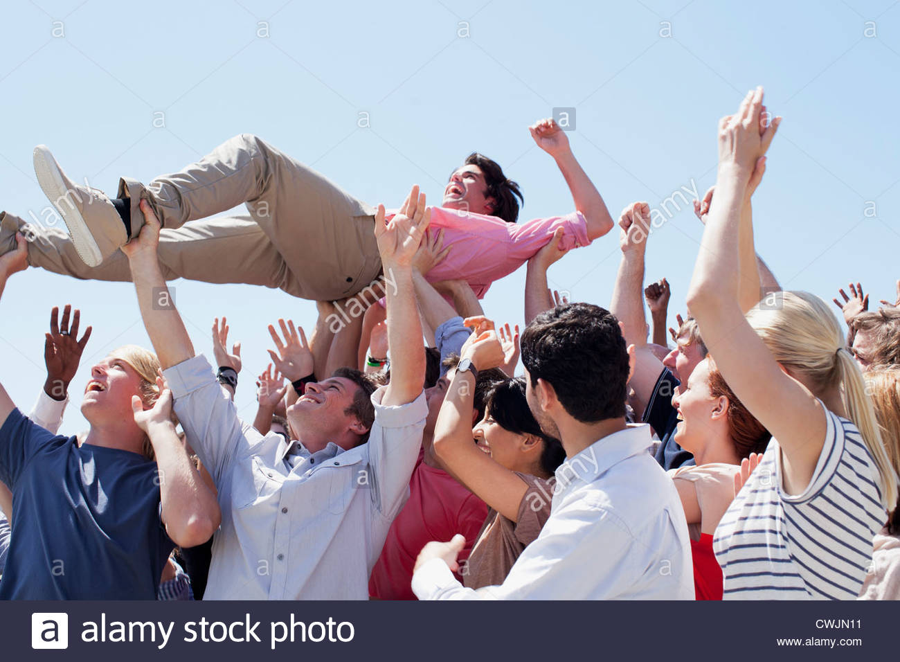 Man crowd surfing - Stock Image