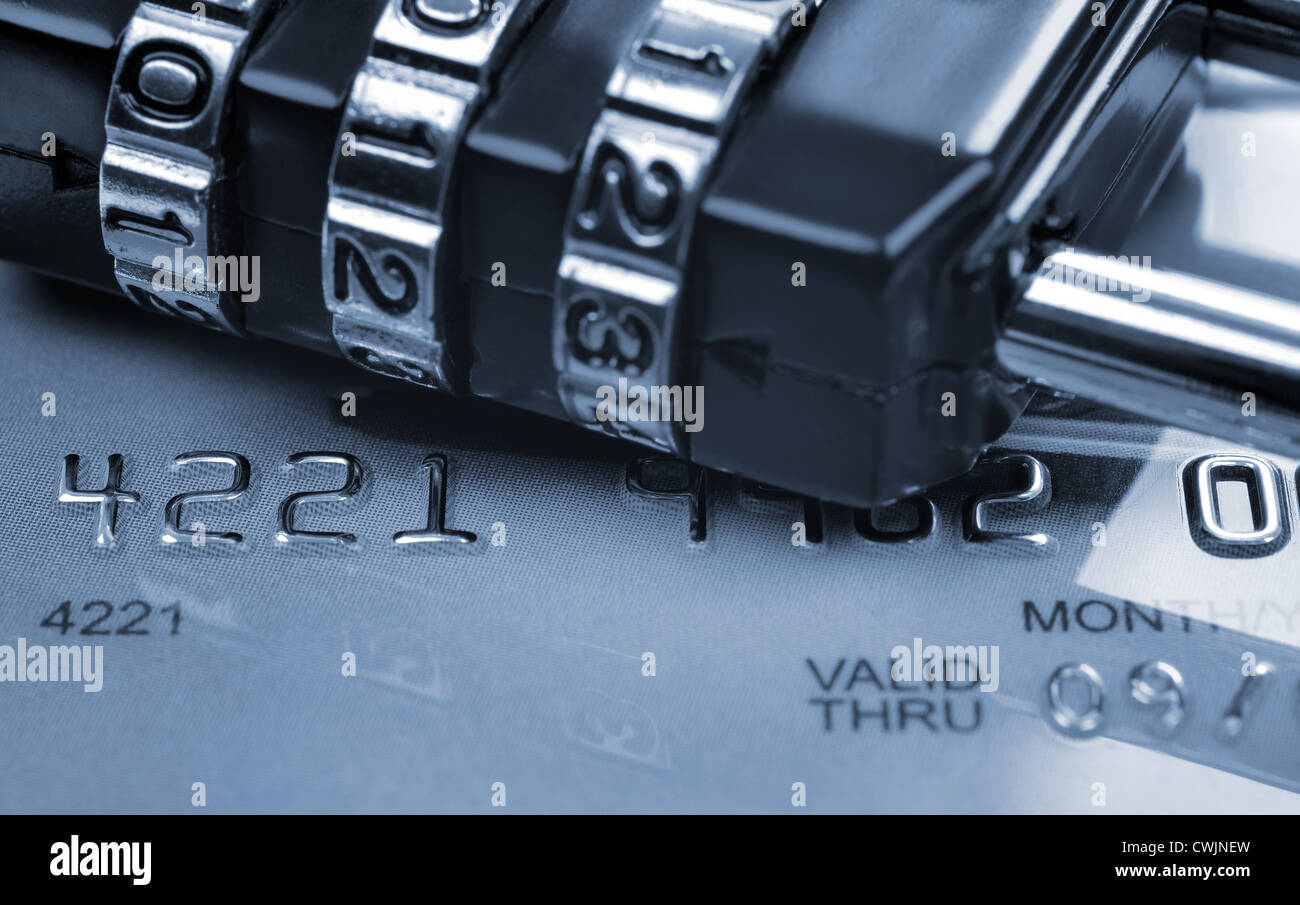 Security concept in transaction (toned in blue). Card expired a few years ago. - Stock Image