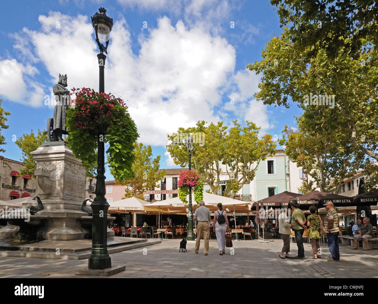 place saint louis aigues mortes france with market stalls couple