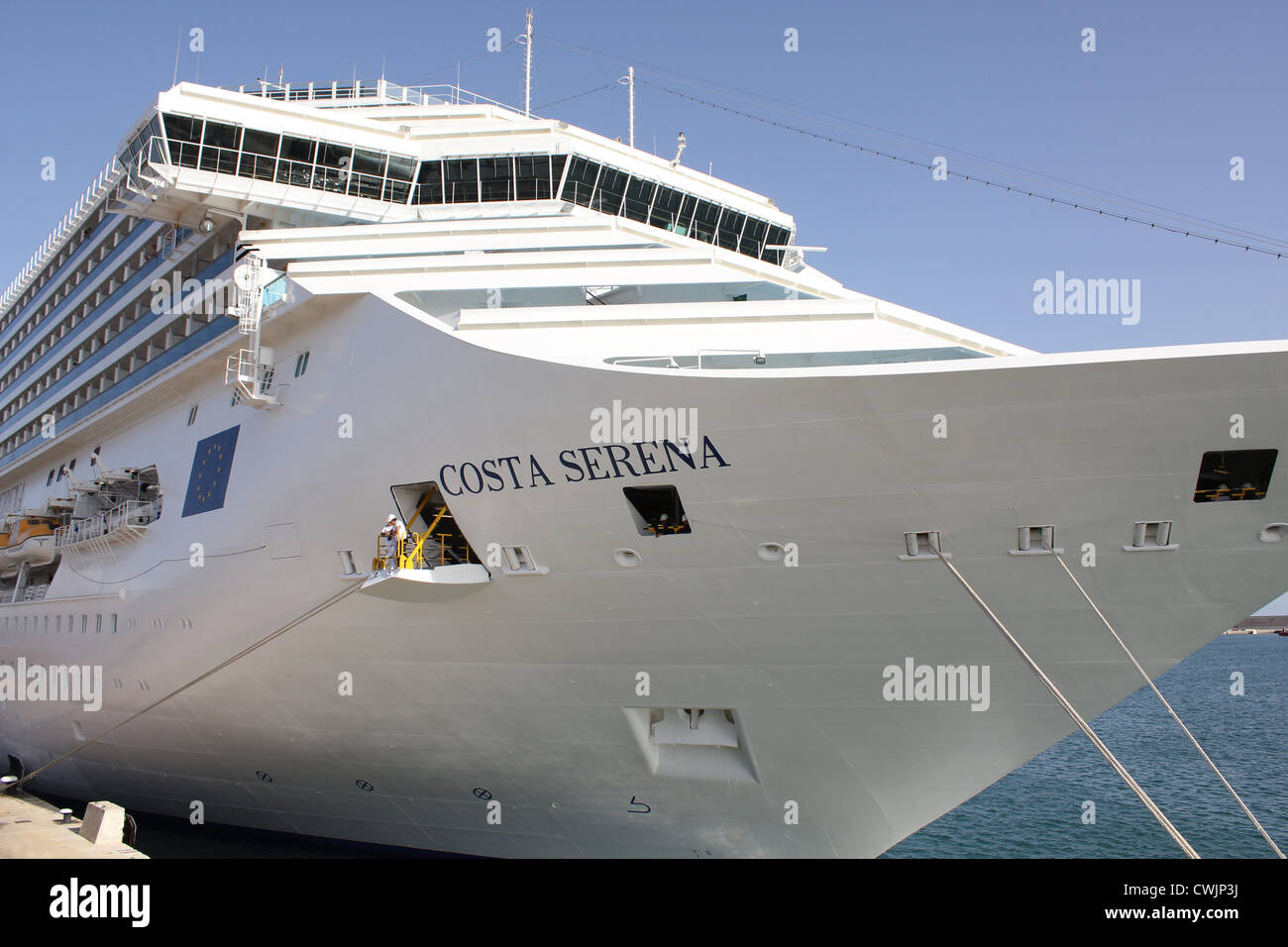 """Costa Cruise Lines cruise ship """"Costa Serena"""" - at late afternoon awaiting late passengers prior to casting off Stock Photo"""