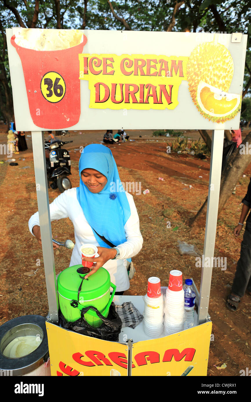 A Muslim woman sells Durian flavored ice cream during Ramadan celebrations in Merdeka Square - Stock Image