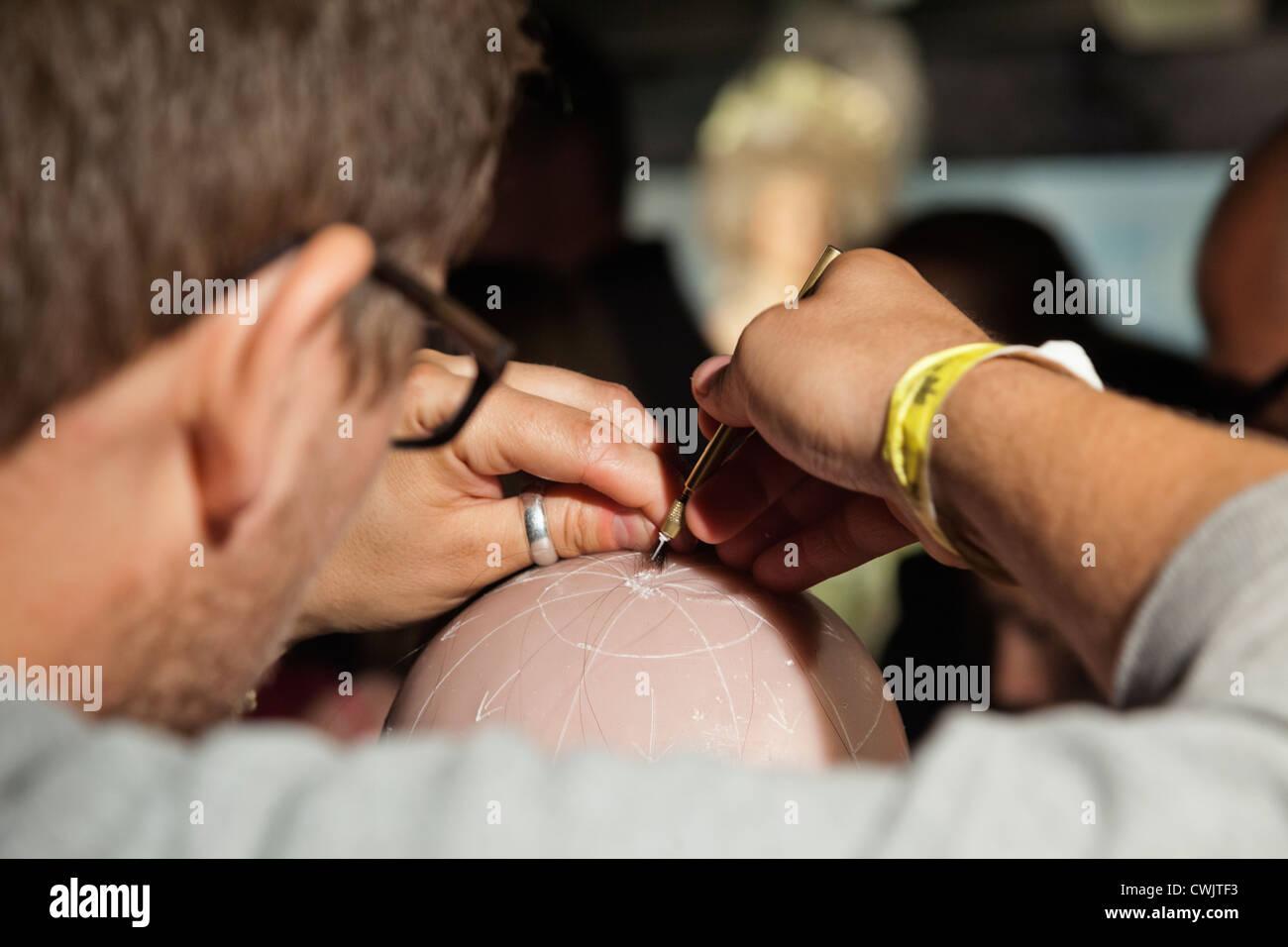 England, London, Madame Tussauds, Demonstration of Implanting Hair into Waxwork Head - Stock Image