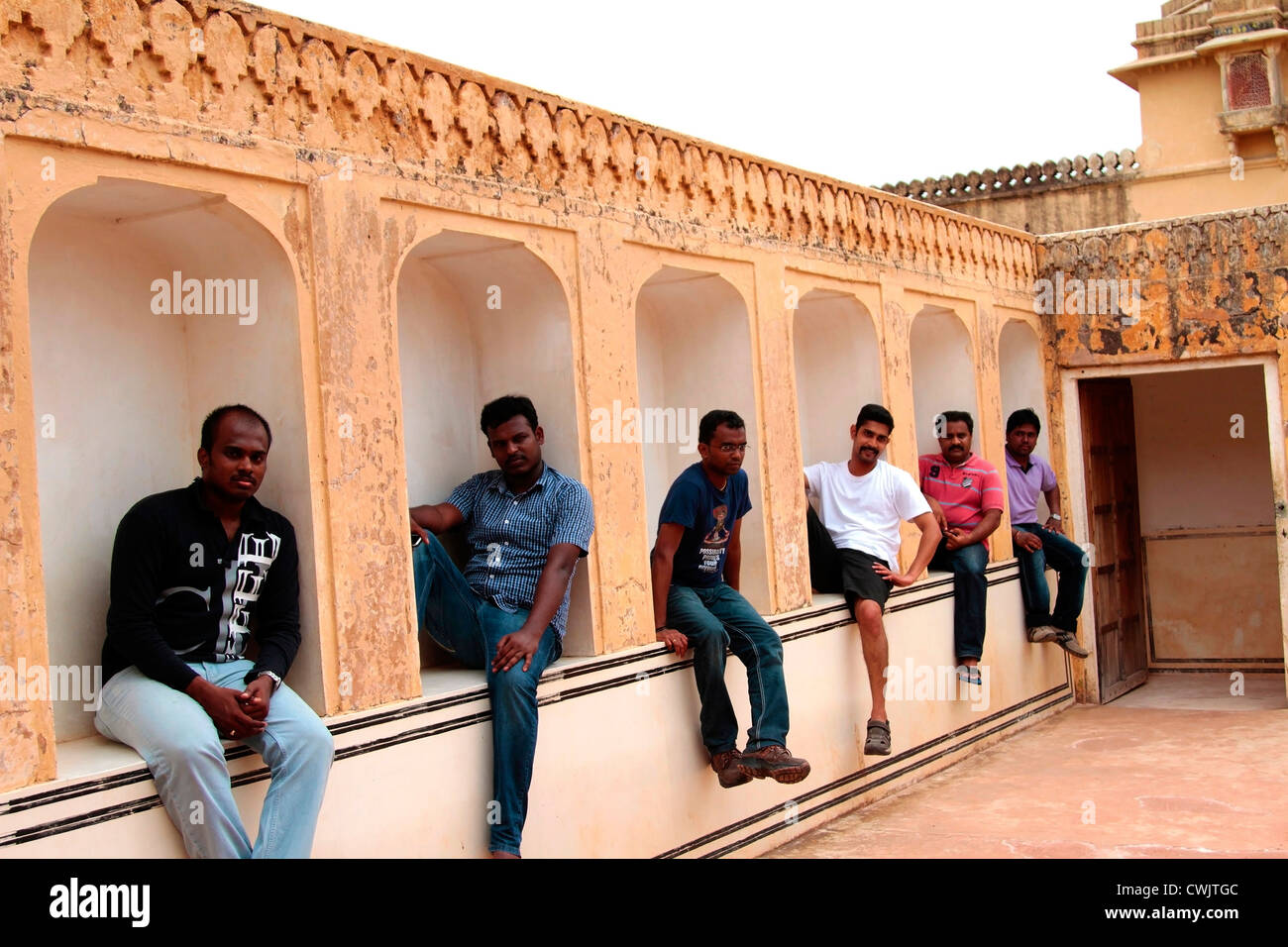 Amer fort,Models,tourist,Peoples,young,Setting on the window,smiling,Amber palace,Jaipur fort,India - Stock Image