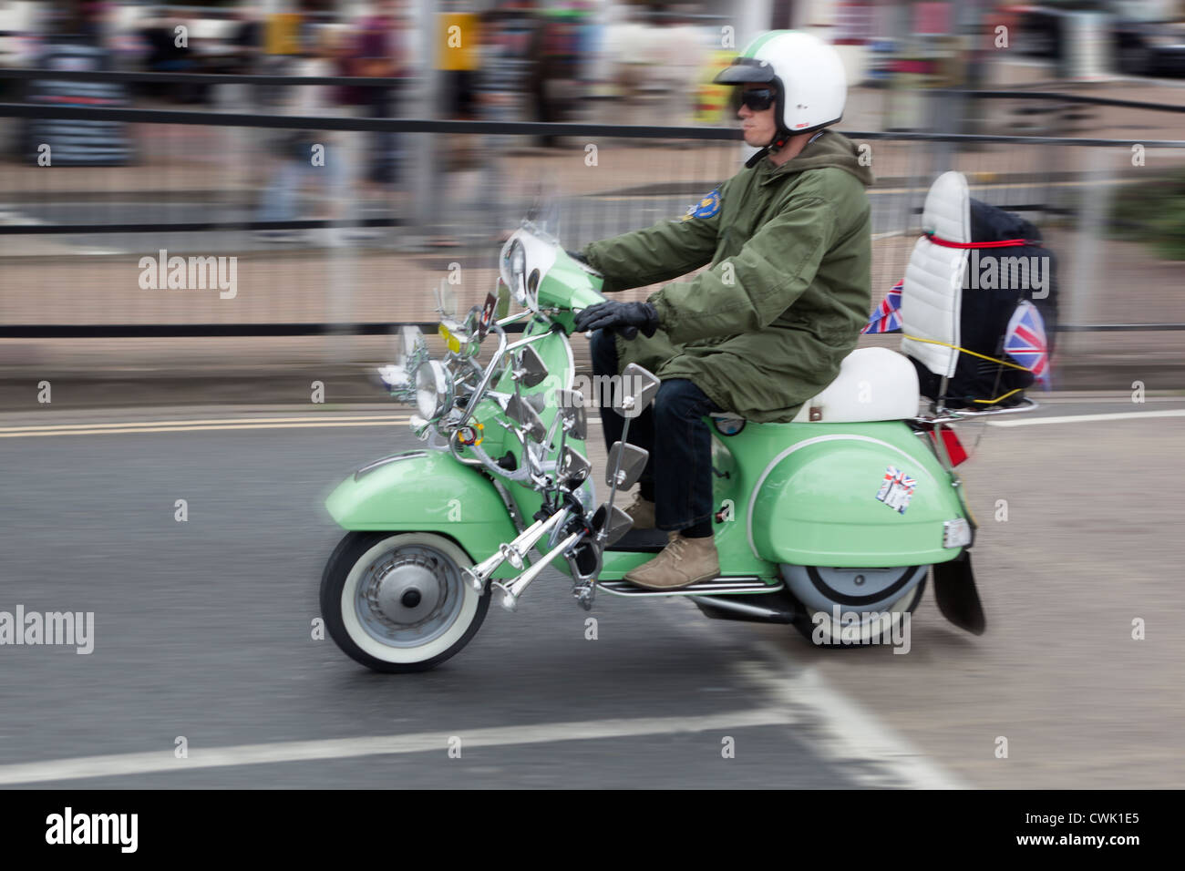 Mod Riding a Vespa Scooter Rally Isle of Wight - Stock Image