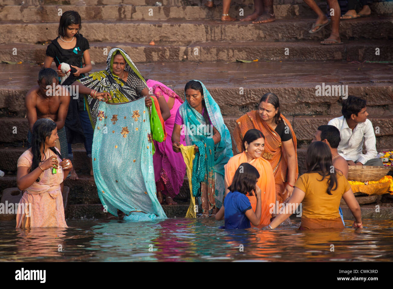 1fafa9fe04e Indian women bathing in polluted water of the Ganges river at Varanasi,  Uttar Pradesh,