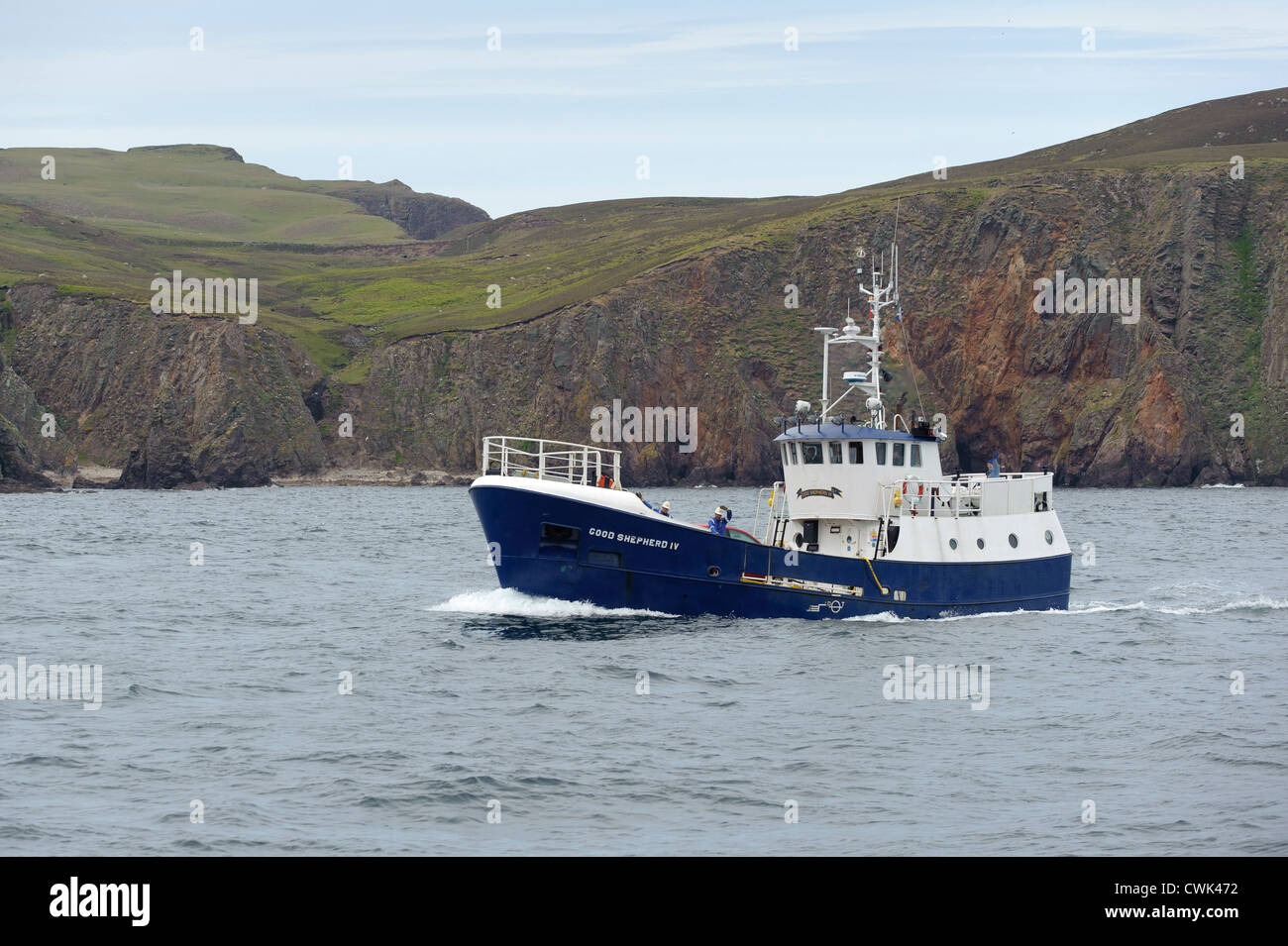Mail boat Good Shepherd IV approaching North Haven on Fair Isle in the Shetland Islands. June 2012. - Stock Image