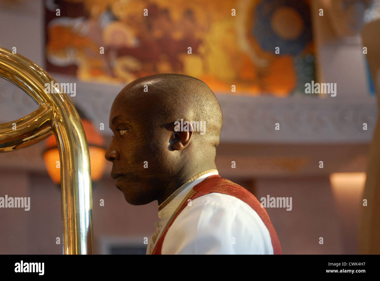 Bellboy in the Atlantis Hotel, The Palm, Dubai, UAE, United Arab Emirates, Persian Gulf, Arabian Peninsula, Asia. - Stock Image
