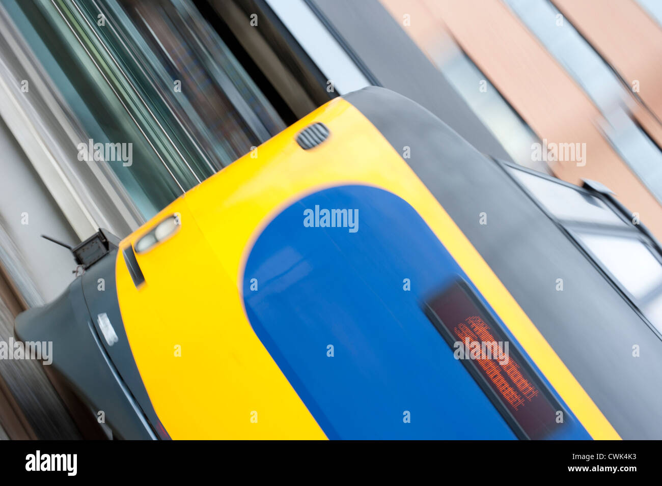 Panning images of a train entering the train station - Stock Image
