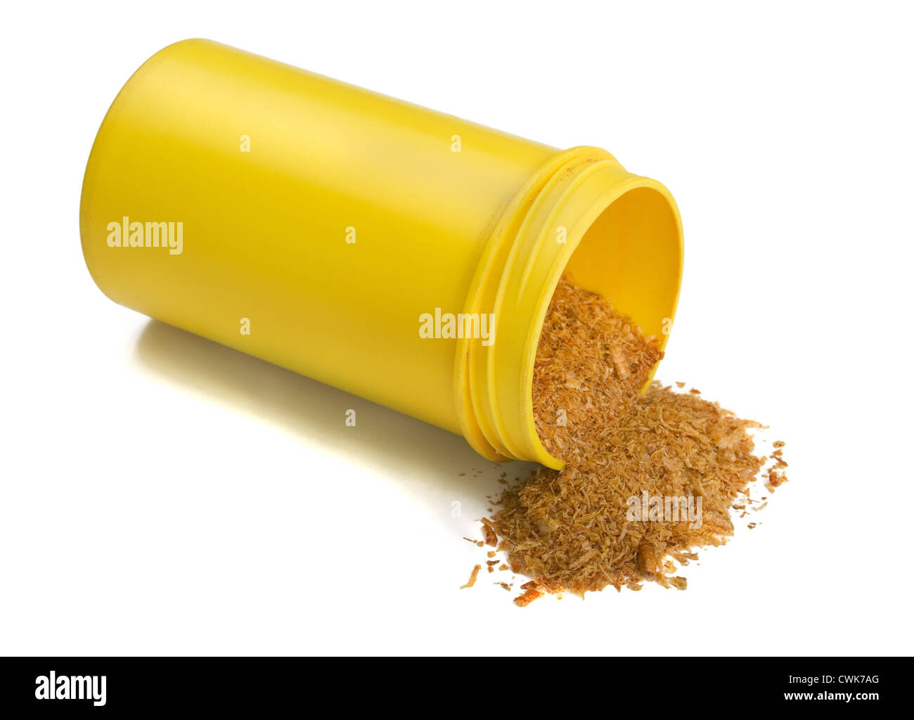 Dried aquarium fish feed in yellow plastic container isolated on white - Stock Image
