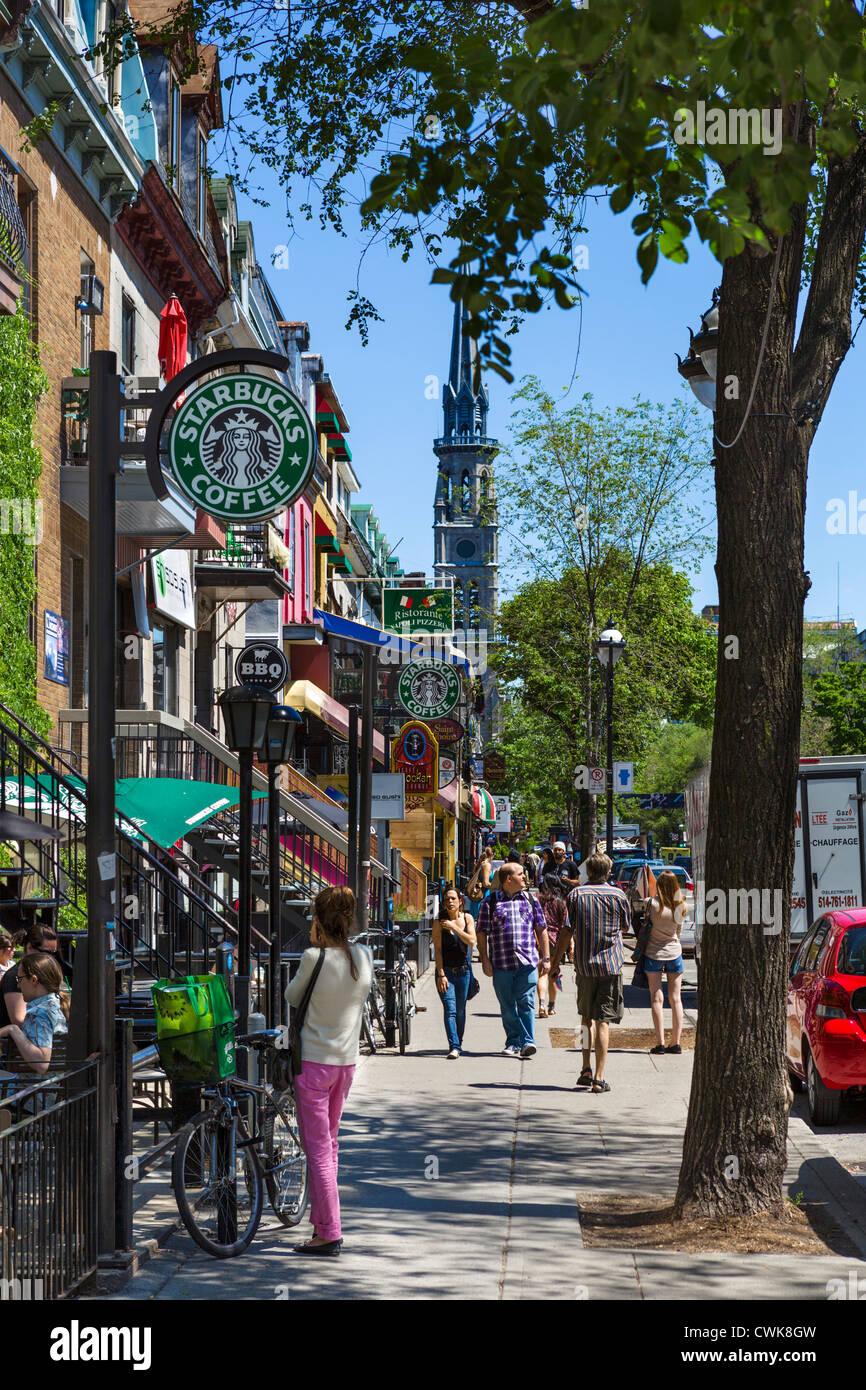 Bars, cafes, restaurants and shops along Rue Saint-Denis in the Quartier Latin (Latin Quarter), Montreal, Quebec, - Stock Image