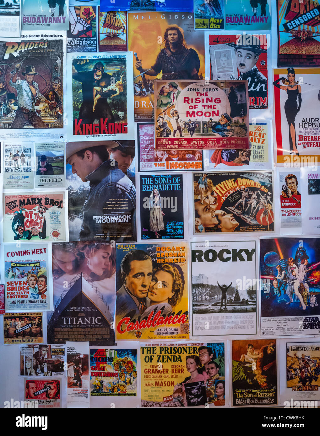Iconic Hollywood movie posters on wall. - Stock Image
