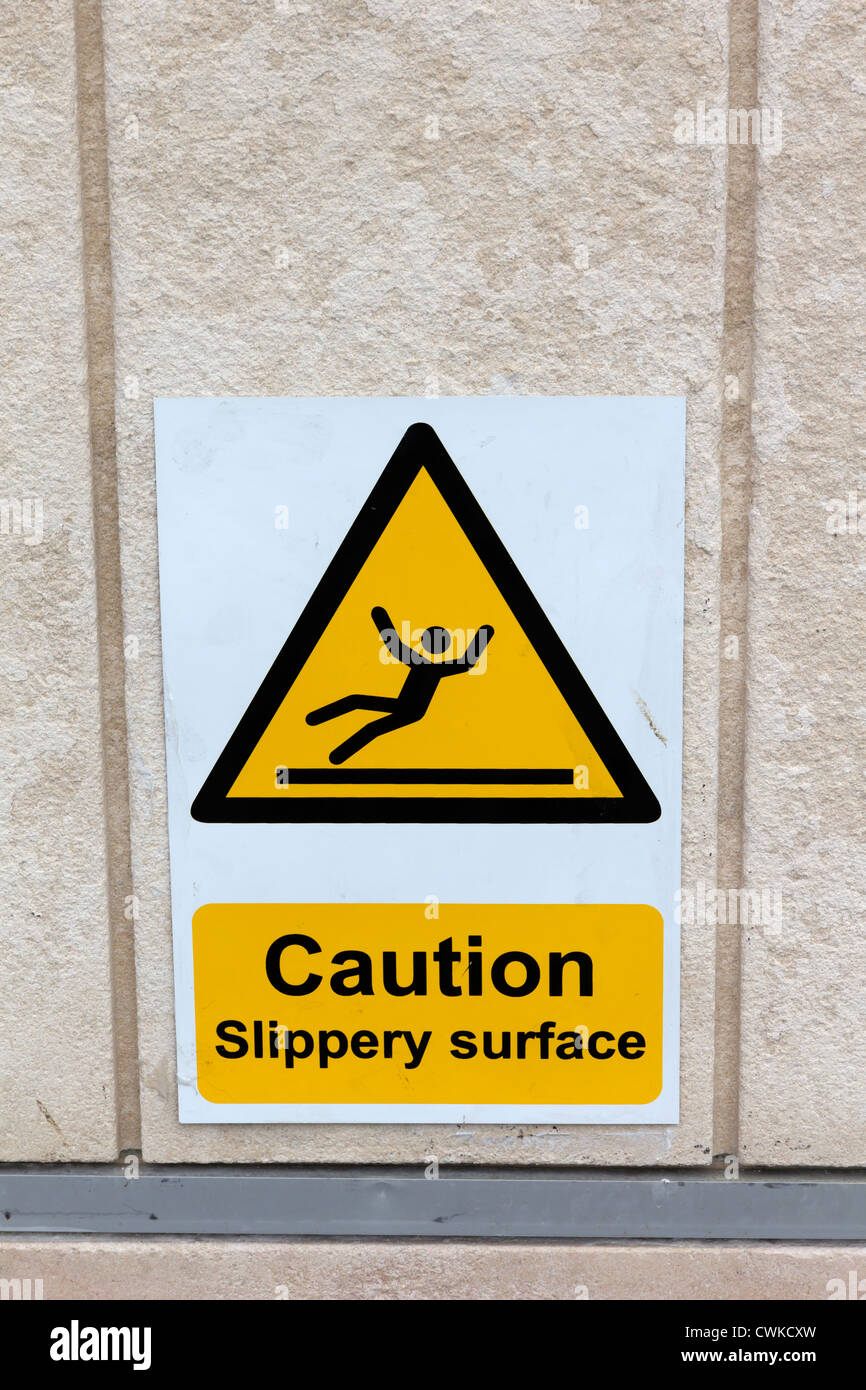 Caution slippery surface sign in Brighton - Stock Image
