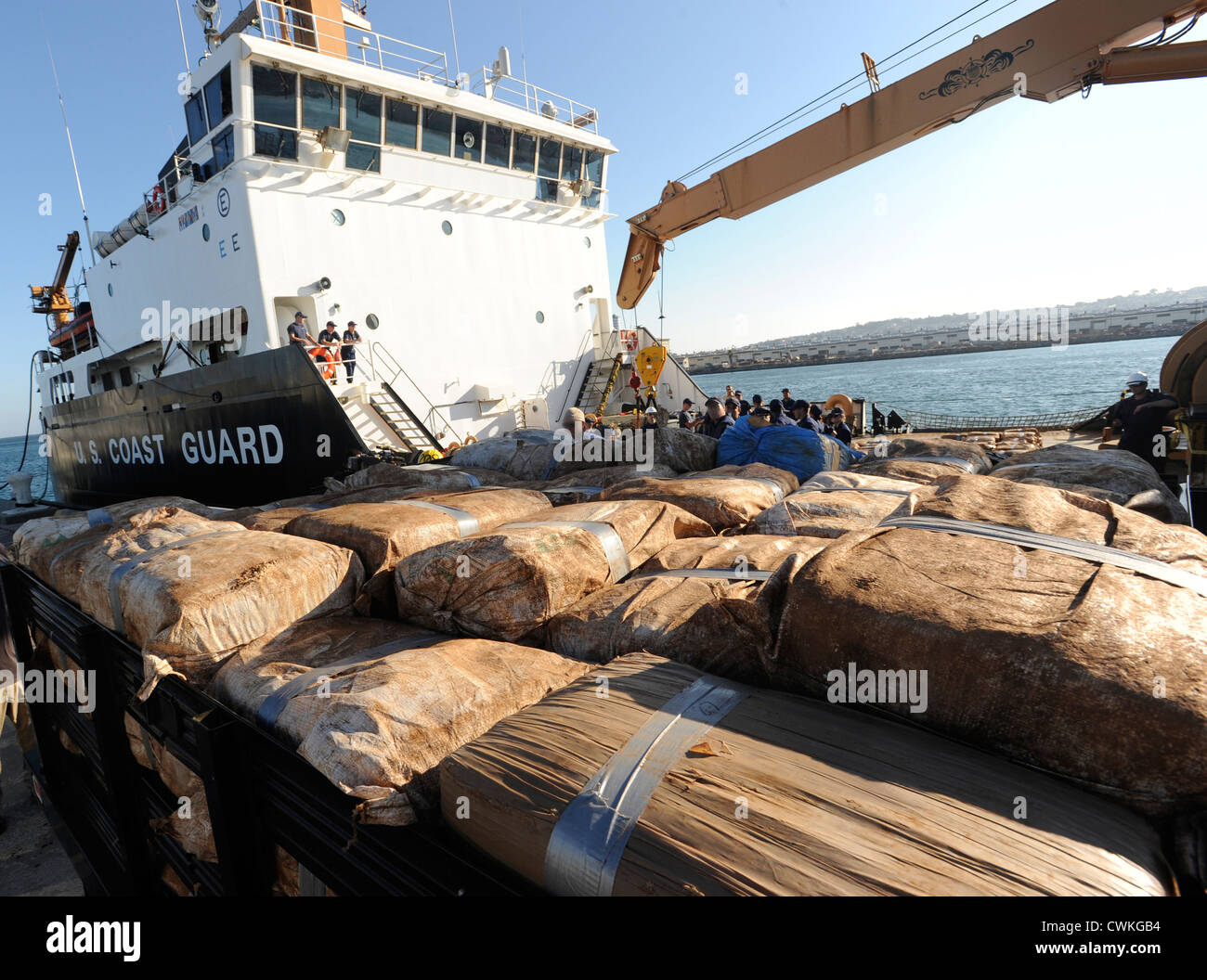 The crew of San Francisco-based Coast Guard Cutter Aspen offloads approximately 8,500 pounds of marijuana at Coast - Stock Image