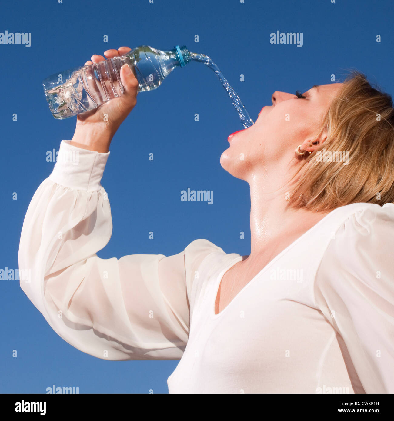 woman drinking some water - Stock Image