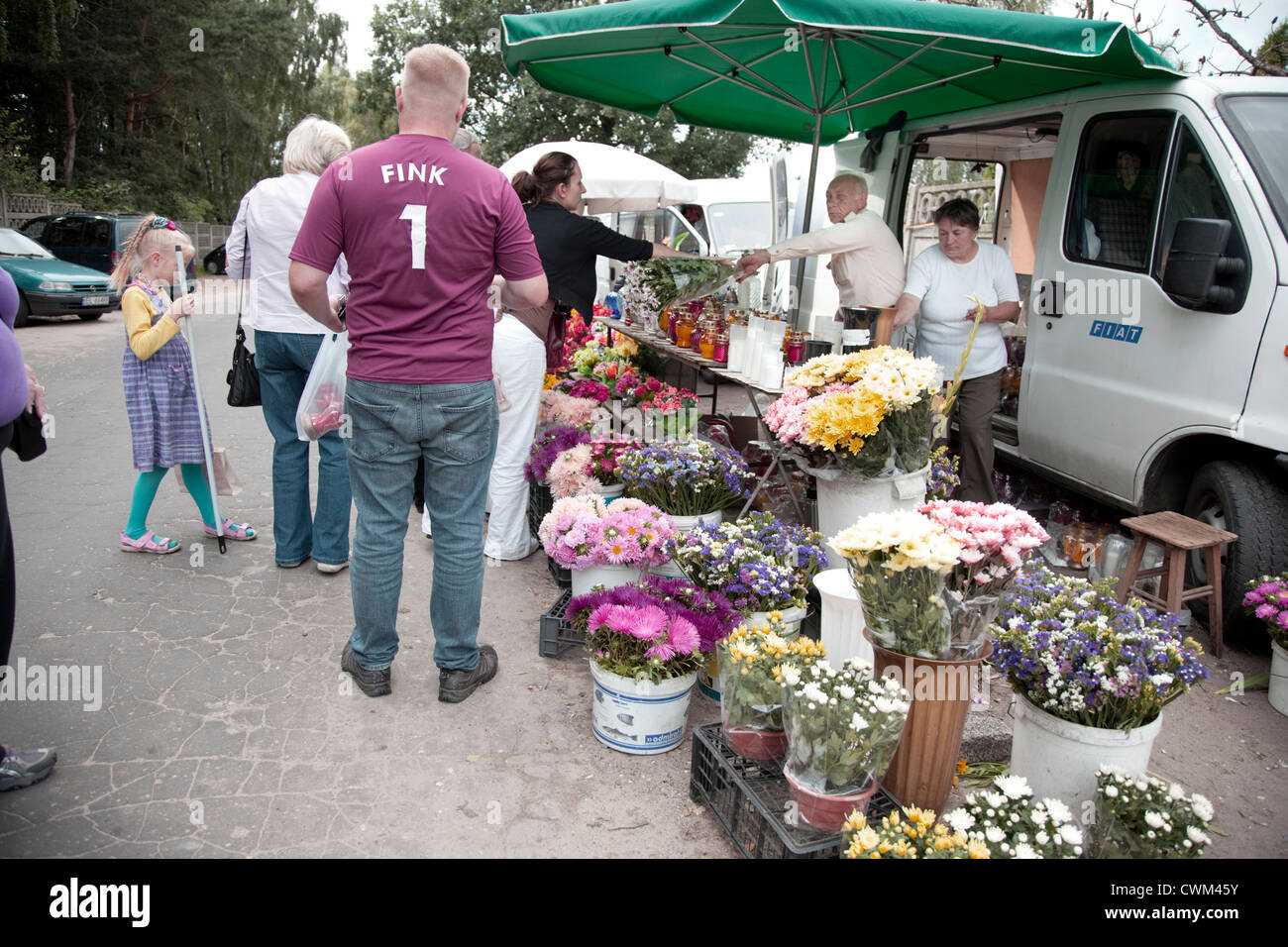 Purchasing flowers outside the gates. Roman Catholic Church's Cemetery Cmentarz Rzymskokatolicki Lodz Central - Stock Image