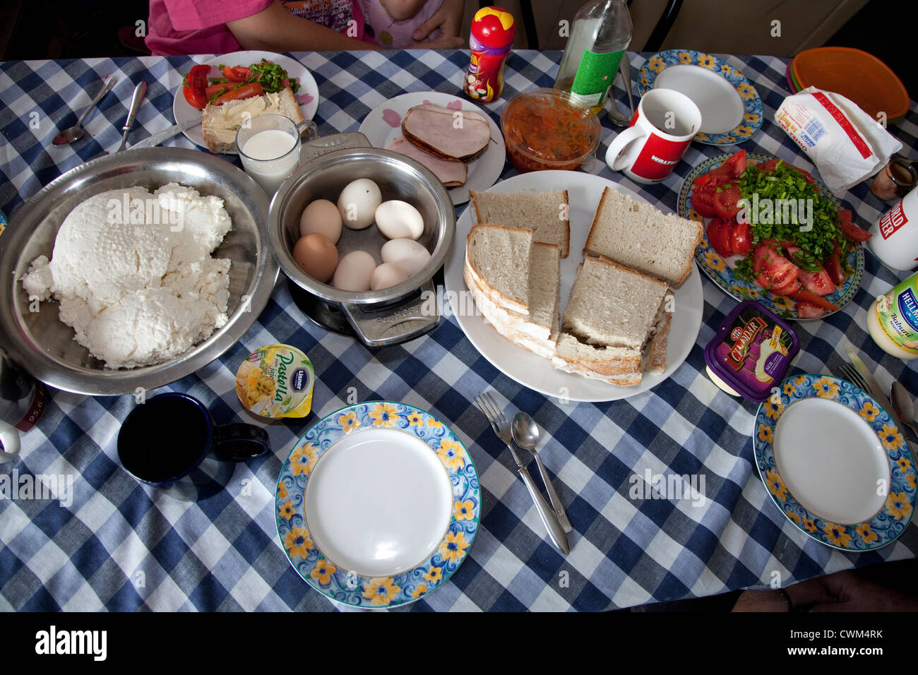 Hearty nutritious Polish country breakfast of eggs, cheese, bread tomatoes, greens and meat. Zawady Central Poland - Stock Image