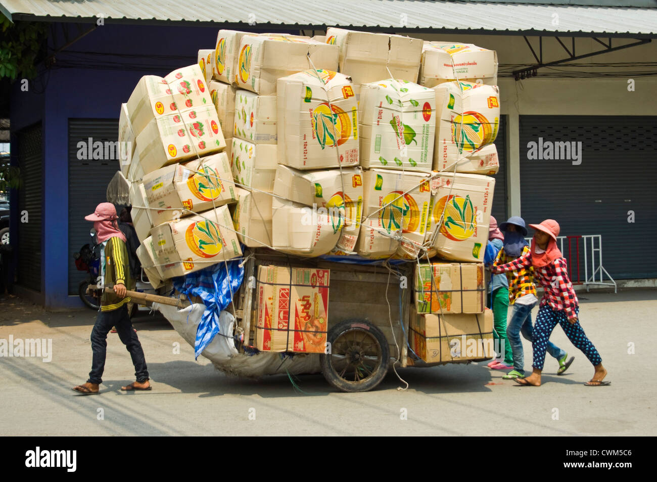 Horizontal Close Up Of A Trolley Overloaded With Full