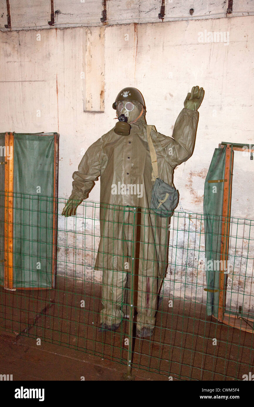 Mannequin displaying a German WWII poisonous gas protective outfit and mask in Hitler's Bunker. Konewka Central - Stock Image