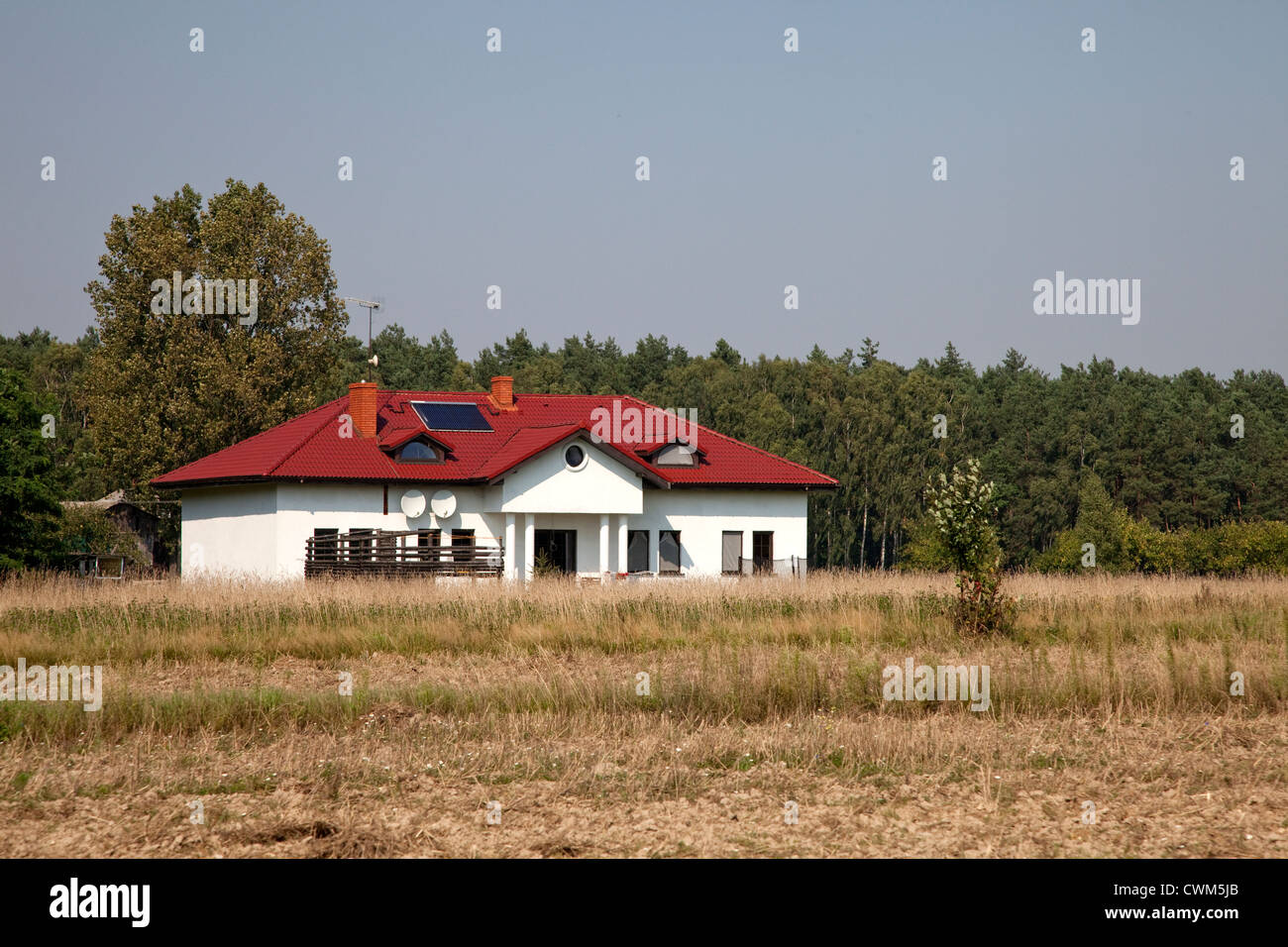 Landlord's beautiful house situated in the center of his tenant's farm. Zawady Central Poland - Stock Image