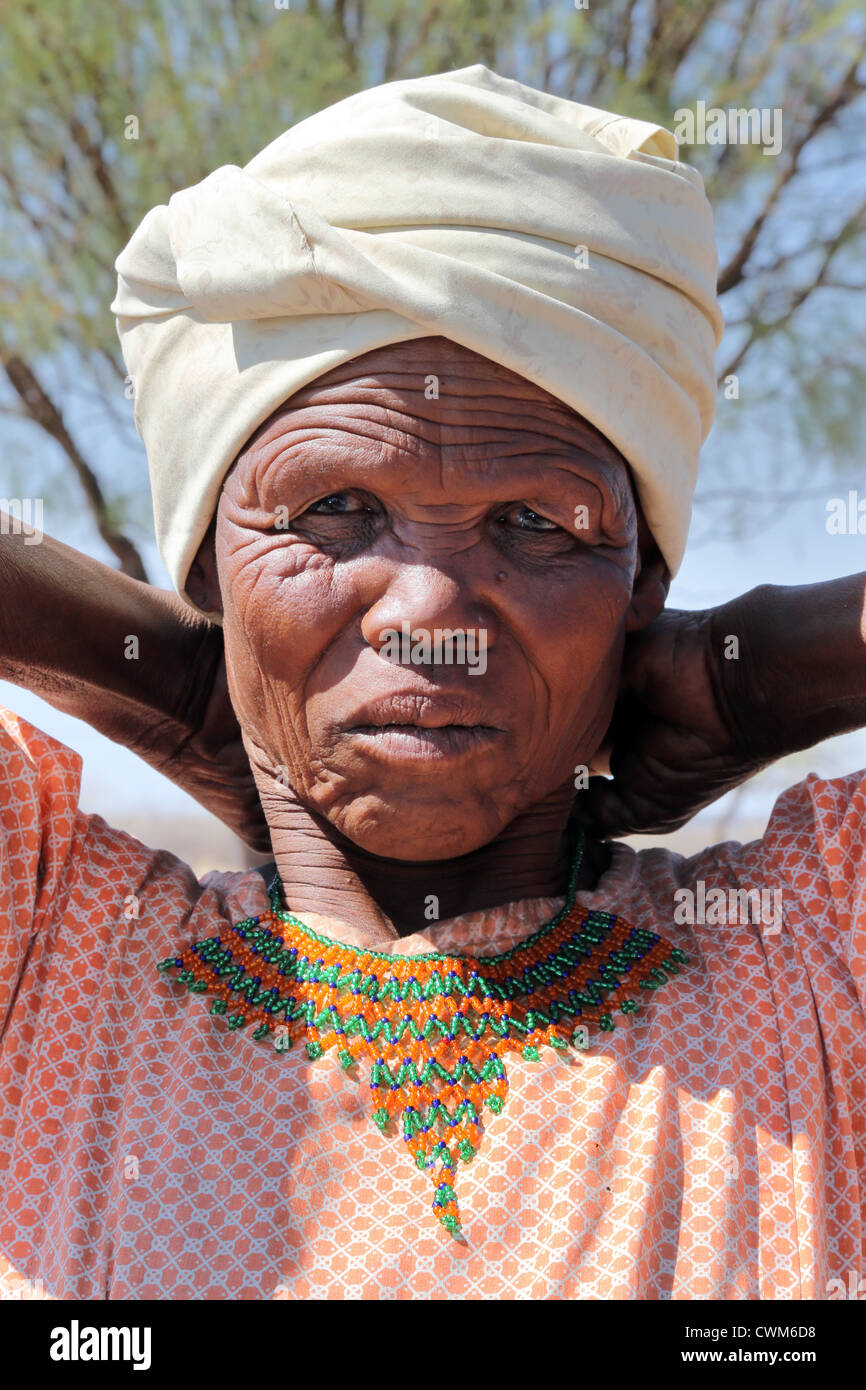 old woman from the San tribe with handmade beaded necklace, Kalahari desert, Namibia - Stock Image