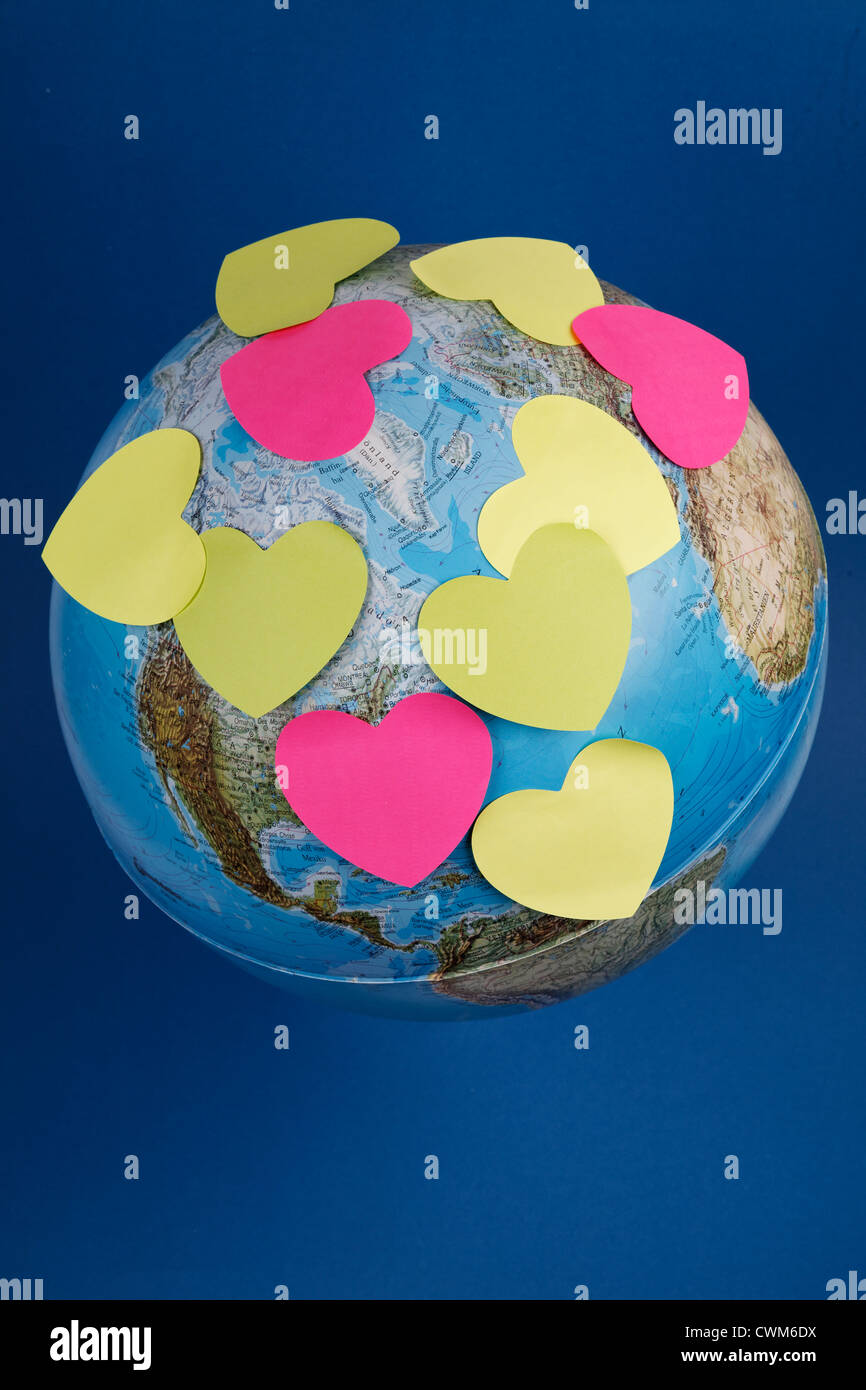 Globe with heart shaped memo stickers - Stock Image