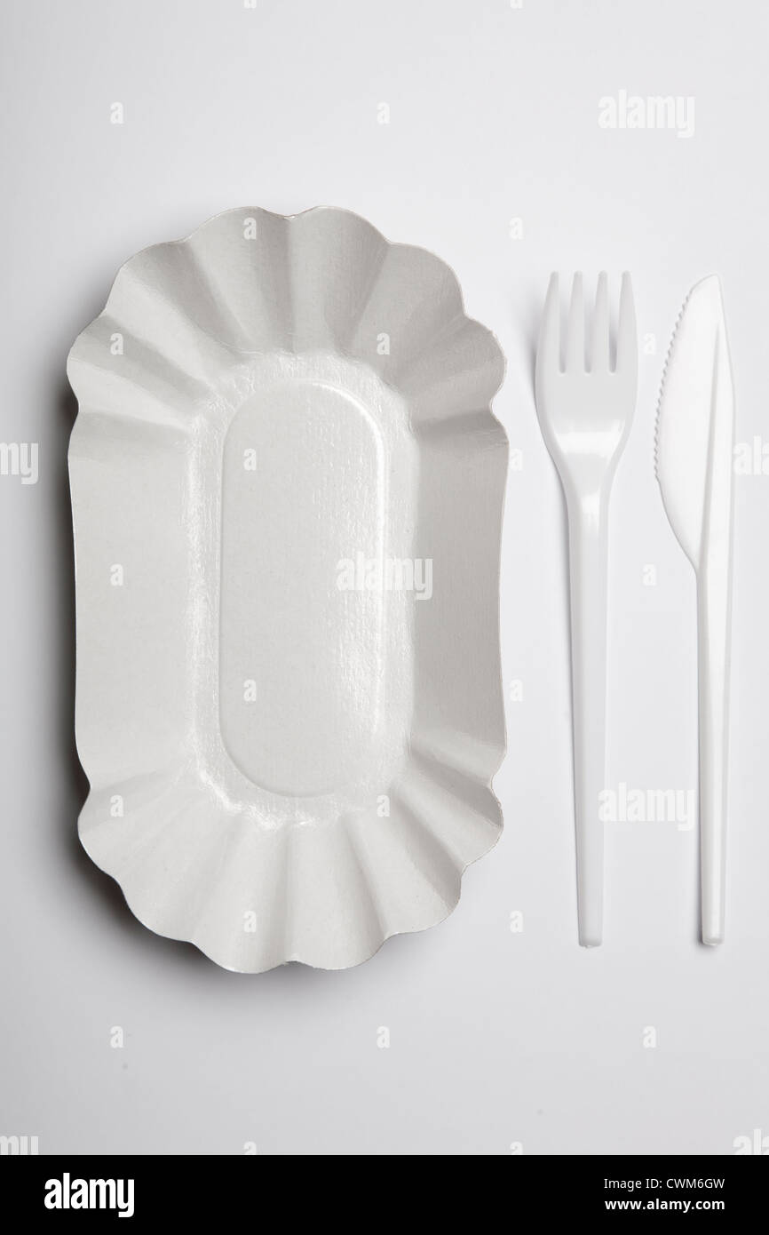 Paper plate with plastic fork and knife on white background & Paper plate with plastic fork and knife on white background Stock ...