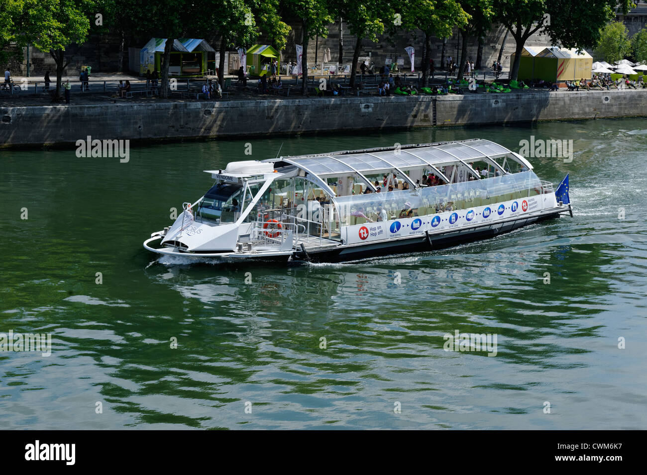Tourist sight seeing boat cruising on the River Seine in PAris, France - Stock Image