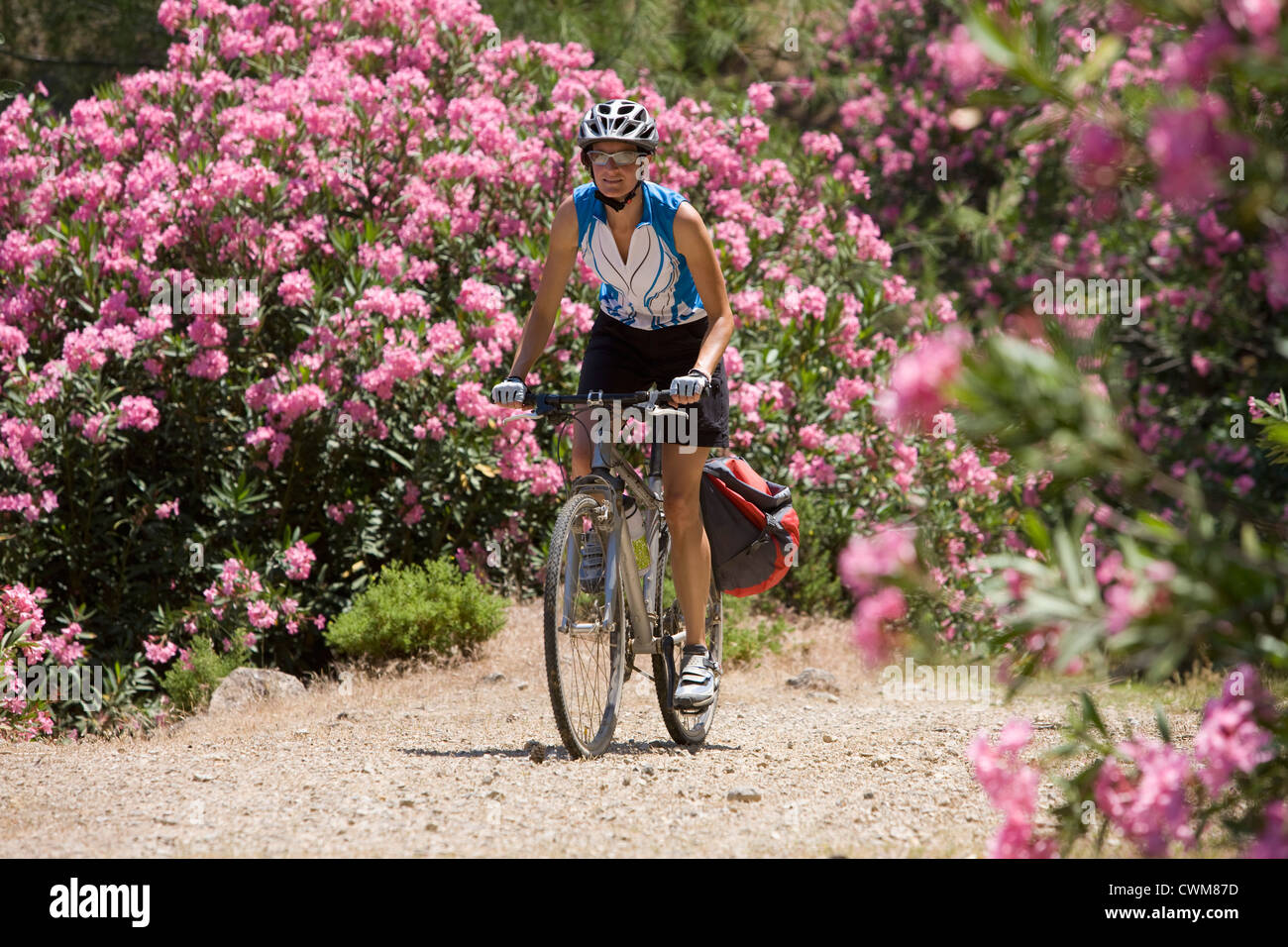 Turkey, Mid adult woman cycling through dirt track - Stock Image