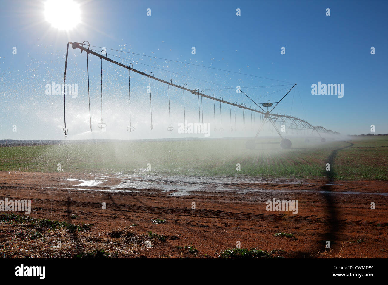 Center pivot crop irrigation system with water sprinklers - Stock Image