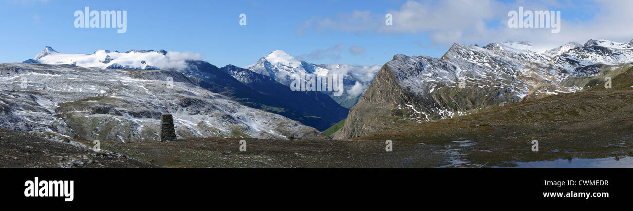 View from Col de l'Iseran, the highest European mountain road, after fresh snow in summer Stock Photo