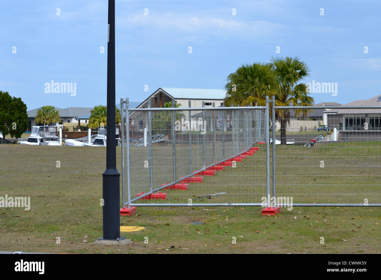 Fenced off canal block of land - Stock Image